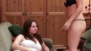 Lesbos in hot lingerie sharing a sensual kiss thumb