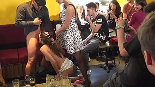 Sexy slave knows hot to work crowd in public thumb