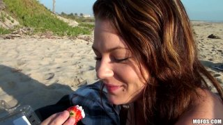 Too whorish and voracious brunette Audrina Ashley teases a cock on the beach thumb