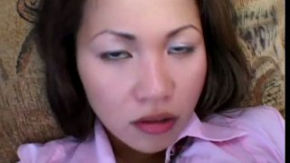 Asian slut Sabrine Maui stretches her mouth lips and pussy lips with a fat and long black dick thumb