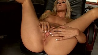 Tanned blond secretary Sophie Moone tickles her fancy on the table thumb