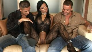 Fantastic brunette Kyra Black seduces two men on the couch thumb