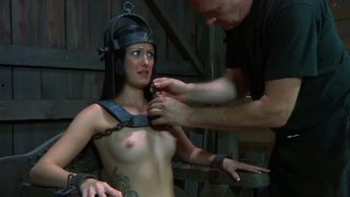 Poor Hailey Young is locked up on a special BDSM style chair thumb