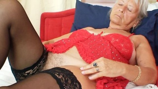 Ugly grandmother Cecilie toys her unshaven cunny thumb