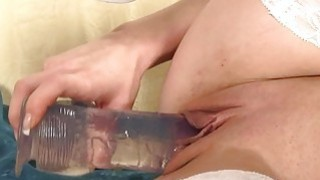 Pretty cowgirl enjoys making her cunt wet and wild thumb