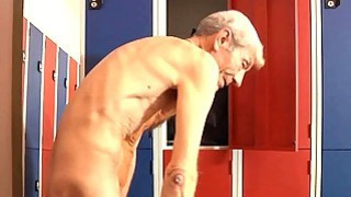 Dirty brunette fucks old geezer in a dressing room thumb