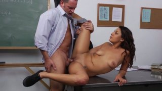 Young brunette Gigi Loren gets her pussy drilled on the table thumb