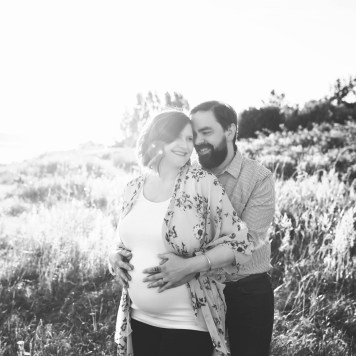 husband and wife maternity session at discovery park in seattle