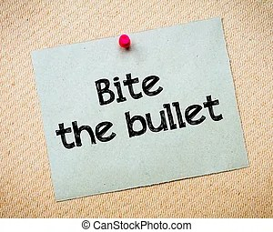 Bite the bullet. Close-up of a woman\\'s mouth biting the... stock image - Search Photos and Photo Clip Art - csp2058986