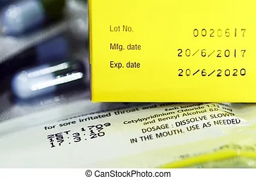 Expiry and manufacture date label. An expiry and manufacture date label on a bottle of multi-vitamin pills.