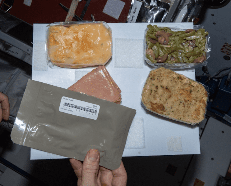 Typical ThanksGiving dinner on the International Space Station. Credit: NASA.
