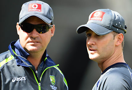 Australian cricket captain Michael Clarke (R) talks with coach Mickey Arthur (L) as Clarke struggles with a hamstring injury, in Melbourne on December 25, 2012, before Australia takes on Sri Lanka in the second cricket Test match starting on December 26 at the Melbourne Cricket Ground (MCG). AFP PHOTO/William WEST