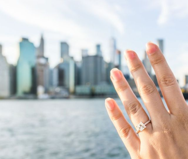 Woman With Engagement Ring Looking At Nyc Skyline