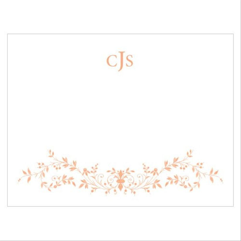 classic white notecard with monogram at the top and gold floral motif along the bottom border
