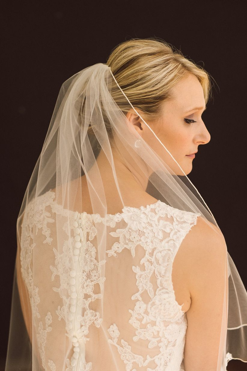 low updo with veil photo tyler boye photography romantic wedding hairstyles