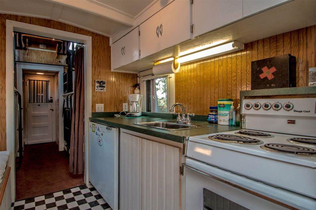 Caboose Tiny Home Turns Antique Train Car Into Cozy Retreat