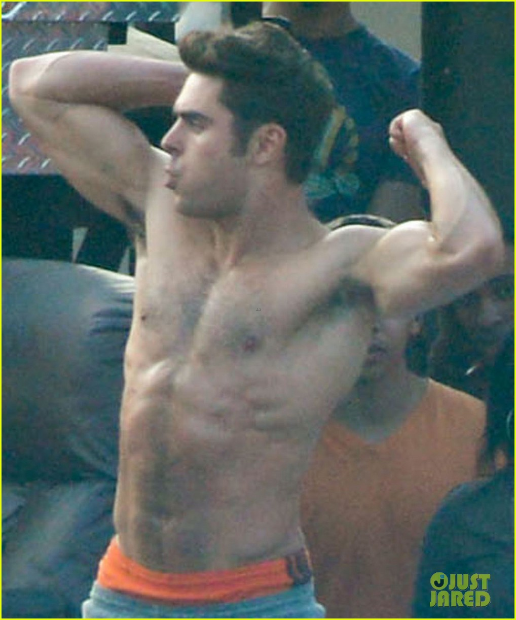 zac efron sticks hand in shorts flaunts eight pack abs 04