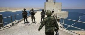 Peshmerga fighters stand guard at Mosul Dam in northern Iraq