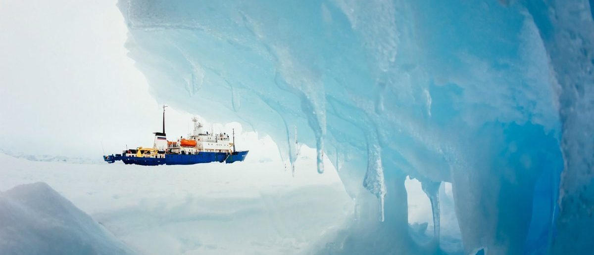 The MV Akademik Shokalskiy is pictured stranded in ice in Antarctica, December 29, 2013. An Antarctic blizzard has halted an Australian icebreaker