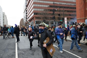 Protesters fleeing from concussion grenades thrown by police - Daily Caller - Grae Stafford