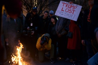 Protestors set fire to inauguration shirts in the streets - Daily Caller - Abbey Jaroma