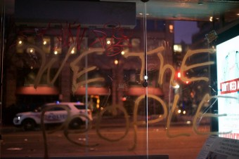Slogans spray painted on a metro bus shelter - Daily Caller - Abbey Jaroma