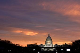 The sun rises over the U.S. Capitol on the National Mall before U.S. President-elect Donald Trump is to be sworn in in Washington, U.S., January 20, 2017. REUTERS/James Lawler Duggan - RTSWGOJ