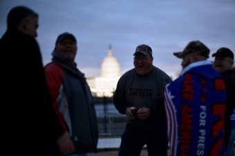 U.S. President-elect Donald Trump supporters gather as the sun begins to rise over the U.S. Capitol on the National Mall before Trump is to be sworn in in Washington, U.S., January 20, 2017. REUTERS/James Lawler Duggan - RTSWGLN