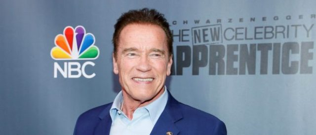 "Host Arnold Schwarzenegger poses after a panel for ""The New Celebrity Apprentice"" in Universal City, California, December 9, 2016. REUTERS/Danny Moloshok"