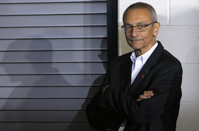 Campaign chairman John Podesta watches from the edge of the stage during a campaign rally with Democratic presidential nominee Hillary Clinton (not pictured) at Heinz Field in Pittsburgh, Pennsylvania, November 4, 2016. REUTERS/Brian Snyder