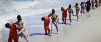 Islamic State militants lead what are said to be Ethiopian Christians along a beach in Wilayat Barqa, in this still image from an undated video made available on a social media website