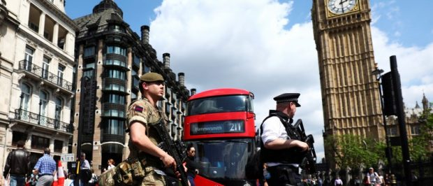 A soldier and an armed policeman pass Big Ben in London, Britain May 24, 2017. REUTERS/Neil Hall