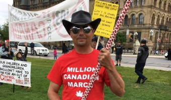 Million Canadian Deplorables March organizer Mike Wain stands in front of Canada's Parliament Hill. Daily Caller photo