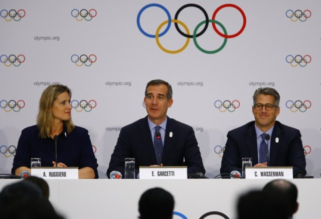 U.S. International Olympic Committee (IOC) member Angela Ruggiero, Mayor of Los Angeles Eric Garcetti and Chairman of the LA 2024 Candidature Committee Casey Wasserman attend the briefing of 2024 Olympic Games candidate cities Paris and Los Angeles ahead of final election of 2024 Olympic host city, in Lausanne, Switzerland July 11, 2017. REUTERS/Pierre Albouy