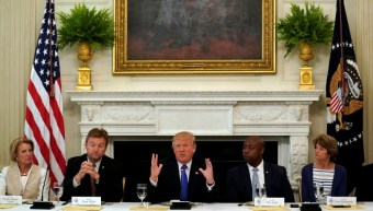 U.S. President Donald Trump speaks during a lunch meeting with Senate Republicans to discuss healthcare at the White House in Washington, U.S., July 19, 2017. From left are U.S. Senators Shelley Moore Capito (R-WV), Dean Heller (R-NV), Tim Scott (R-SC) and Lisa Murkowski (R-AK). REUTERS/Kevin Lamarque