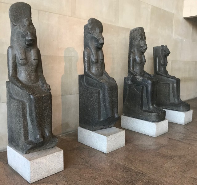 Four statues of the goddess Sachet face the Temple of Dendur in the Sackler Wing at the Metropolitan Museum of Art in New York City. (DCNF/Ethan Barton)