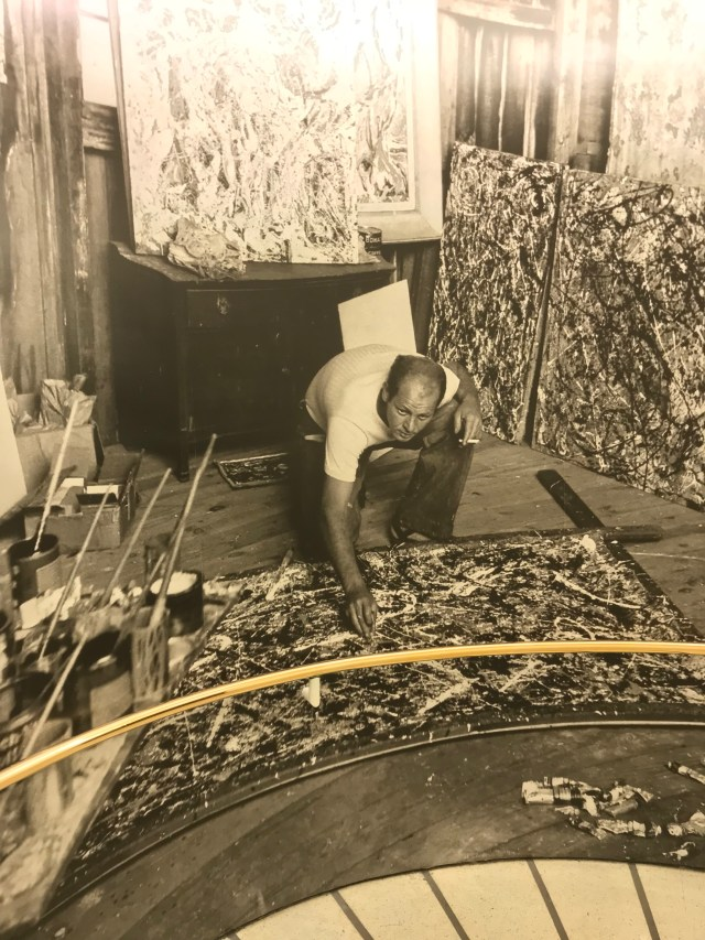 A photo of Jackson Pollock working on Alchemy was plastered on the wall in the Sackler Center for Arts Education at the Guggenheim Museum. (DCNF/Ethan Barton)
