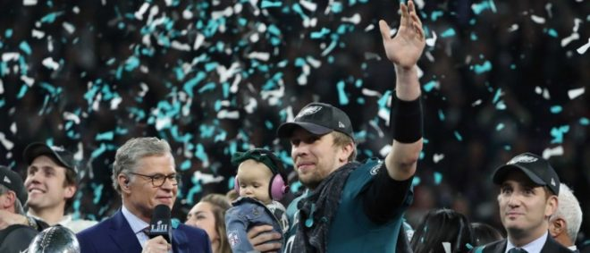 NFL Football - Philadelphia Eagles v New England Patriots - Super Bowl LII - U.S. Bank Stadium, Minneapolis, Minnesota, U.S. - February 4, 2018. Philadelphia Eagles Nick Foles celebrates winning Super Bowl LII with his daughter. REUTERS/Chris Wattie