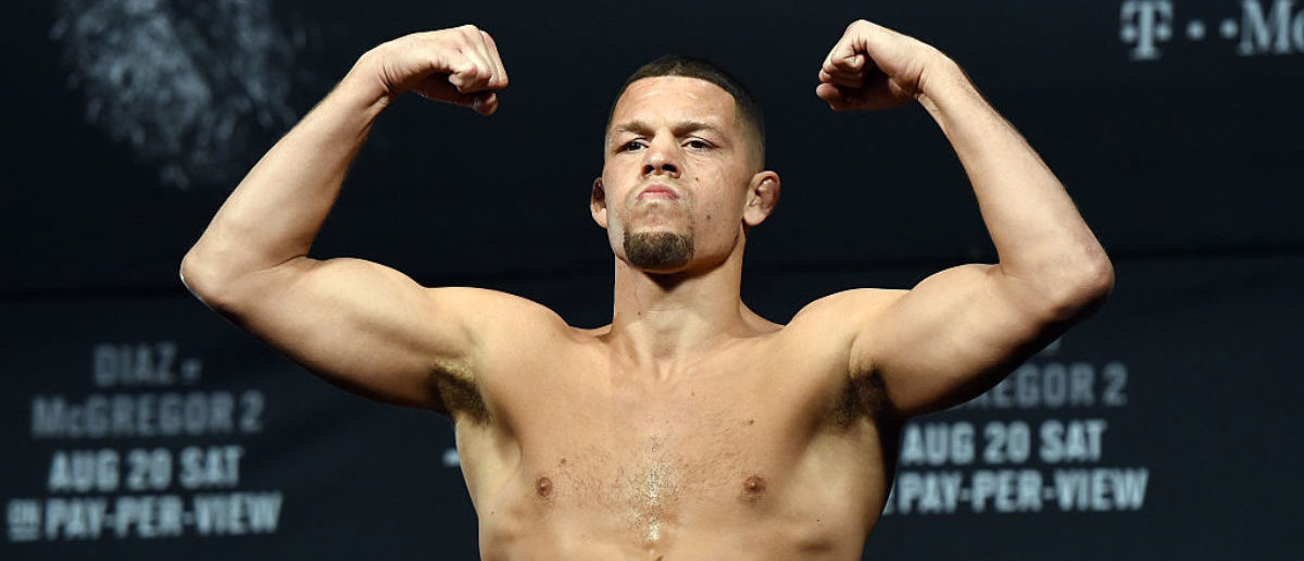 Mixed martial artist Nate Diaz poses on the scale during his weigh-in for UFC 202 at MGM Grand Conference Center on August 19, 2016 in Las Vegas. (Photo by Ethan Miller/Getty Images)
