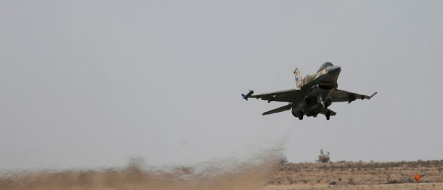 An Israeli F-16 fighter jet takes off at Ramon air base in southern Israel during routine training, October 21, 2013. REUTERS/Amir Cohen