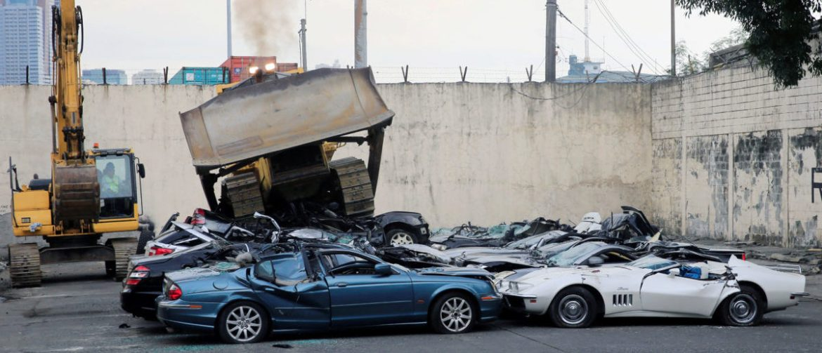 A bulldozer destroys condemned smuggled luxury cars worth 61,626,000.00 pesos (approximately US$1.2 million), which include used Lexus, BMW, Mercedes-Benz, Audi, Jaguar and Corvette Stingray, during the 116th Bureau of Customs founding anniversary in Metro Manila, Philippines February 6, 2018. REUTERS/Romeo Ranoco