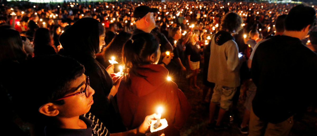 People attend a candlelight vigil the day after a shooting at Marjory Stoneman Douglas High School in Parkland, Florida, U.S. February 15, 2018.  REUTERS/Jonathan Drake