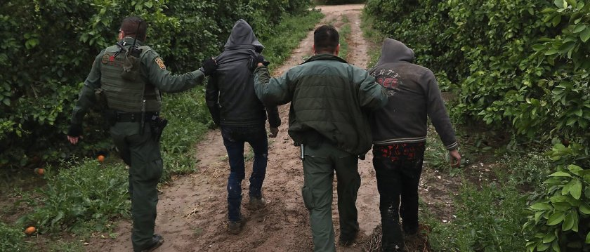 U.S. Border Patrol agents detain  undocumented immigrants from Central America after capturing them in a grapefruit orchard on February 22, 2018 near McAllen, Texas. The group had crossed from Mexico into Texas only moments before.  (Photo by John Moore/Getty Images)