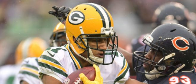 CHICAGO, IL - NOVEMBER 12:  Trevor Davis #11 of the Green Bay Packers carries the football against  Sam Acho #93 of the Chicago Bears in the second quarter at Soldier Field on November 12, 2017 in Chicago, Illinois.  (Photo by Stacy Revere/Getty Images)