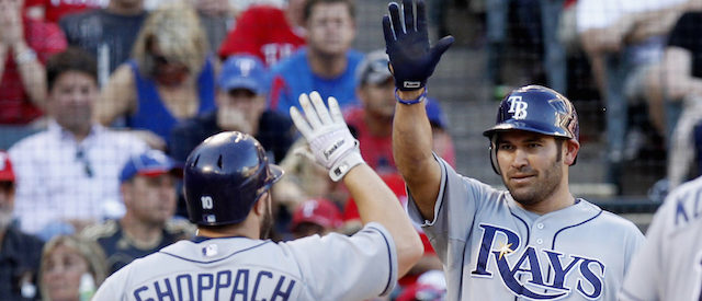 Tampa Bay Rays' Kelly Shoppach (L) is congratulated by teammate Johnny Damon after he hit a two run home run in the fifth inning against the Texas Rangers during Game 1 of their MLB American League Division Series baseball playoffs at Rangers Ballpark in Arlington, Texas, September 30, 2011.  REUTERS/Mike Stone (UNITED STATES - Tags: SPORT BASEBALL) - GM1E7A10K2T01