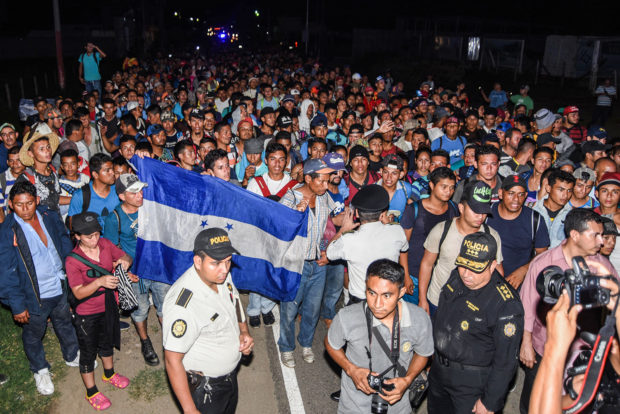 Honduran migrants taking part in a new caravan heading to the US, arrive to Chiquimula, Guatemala, on October 22, 2018. - US President Donald Trump on Monday called the migrant caravan heading toward the US-Mexico border a national emergency, saying he has alerted the US border patrol and military. ORLANDO ESTRADA/AFP/Getty Images