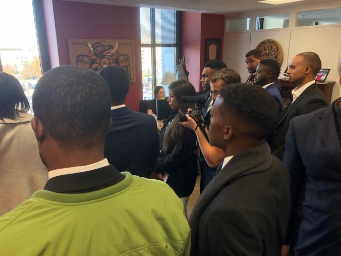 """African-American conservatives gather in Republican Sen. Lisa Murkowski's office on Wednesday, Nov. 28, to lobby in favor of the """"First Step Act""""."""