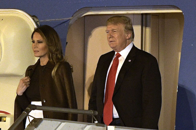 US President Donald Trump (R) and US First Lady Melania Trump, are pictured before leaving Air Force One, upon arrival at Ezeiza International airport in Buenos Aires province, on November 29, 2018, on the eve of the G20 Leaders' Summit. - US President Donald Trump jets into Argentina on Thursday for a G20 summit, keen to do battle with China on trade and sharpening his rhetoric against Russia over Ukraine. (Photo credit: JUAN MABROMATA/AFP/Getty Images)