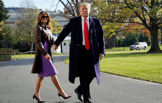 U.S. President Donald Trump walks with first lady Melania Trump as they depart on travel to Argentina from the White House in Washington, U.S., November 29, 2018. REUTERS/Jonathan Ernst