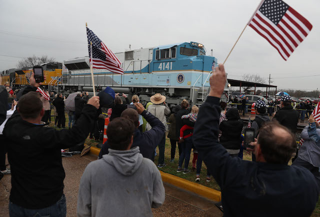 People wave at the train carrying the casket of former U.S. President George H.W. Bush to the George H.W. Bush Presidential Library at Texas A&M University on December 6, 2018 in Navasota, Texas. President Bush will be buried at his final resting place at the George H.W. Bush Presidential Library at Texas A&M University in College Station, Texas. A WWII combat veteran, Bush served as a member of Congress from Texas, ambassador to the United Nations, director of the CIA, vice president and 41st president of the United States. (Photo by Justin Sullivan/Getty Images)